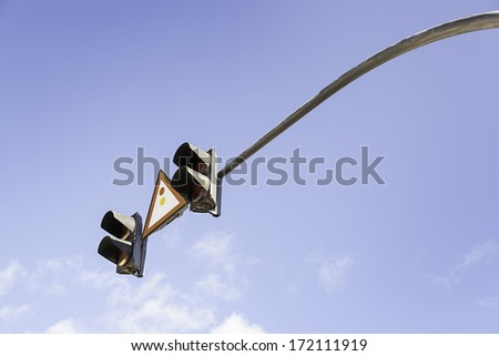 Traffic light in the sky, detail of a traffic signal for vehicles, safety and information - stock photo