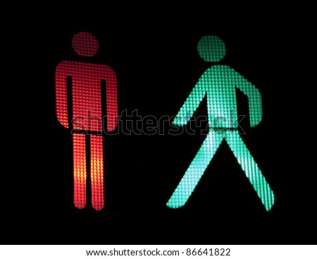 Traffic light of pedestrians. Isolated black - stock photo