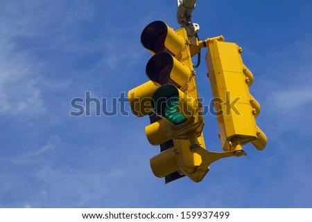 Traffic light on green - stock photo