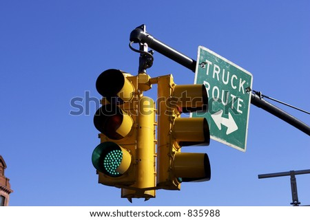 Traffic light on green, Manhattan, New York, America, USA - stock photo
