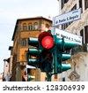 Traffic light on the corner of piazza di Ponte St. Angelo and via del Banco di St. Spirito in Rome, Italy - stock photo