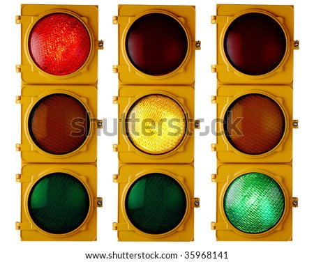 """Traffic light repeated three times, each with a different light """"on"""" - stock photo"""
