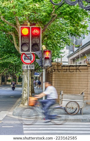 Traffic light set and traffic road sign at intersection in China - stock photo