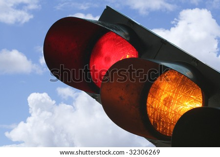 Traffic light showing red and yellow - stock photo