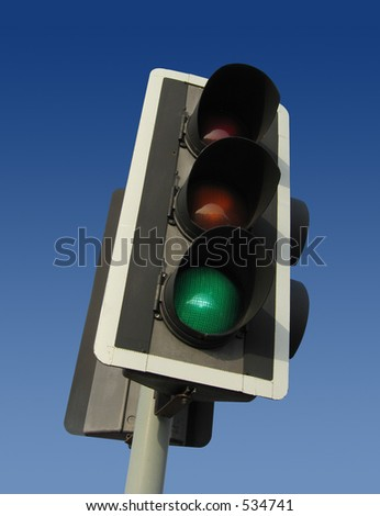 Traffic light showing the green light - contains clipping path for easy cut-out. - stock photo