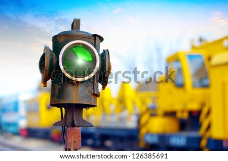 Traffic light shows green signal on railway. Green light - stock photo