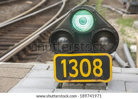 Traffic light shows green signal on railway. Green light.