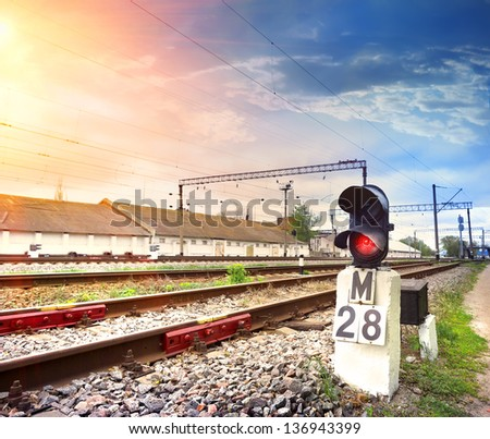Traffic light shows red signal on railway - stock photo