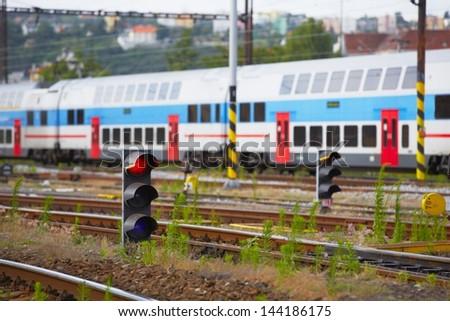 Traffic light shows red signal on railway - Railway station. - stock photo