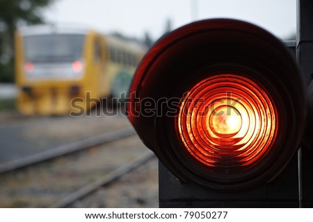 Traffic light shows red signal on railway. Railway station. - stock photo