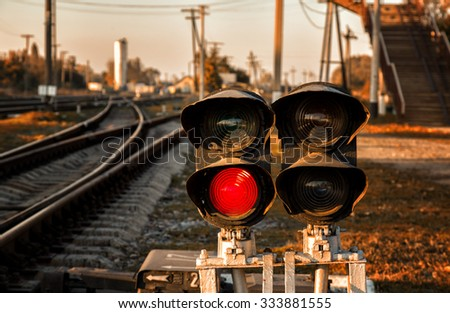 Traffic light shows red signal on railway. Ukrainian railways. - stock photo