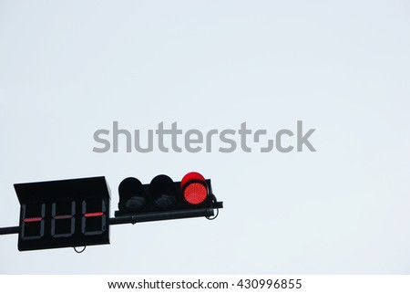 Traffic light signs shows red signal in lurid sky . No Entry - stock photo