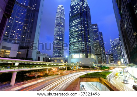 traffic light stream and highrise bulidings - stock photo