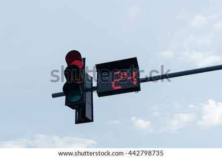 traffic light, the red light is lit.  Wait 24