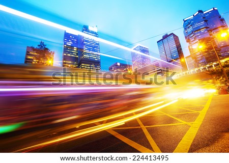 traffic light trails of modern business city   - stock photo