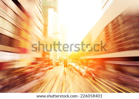 traffic light trails of modern business city - stock photo