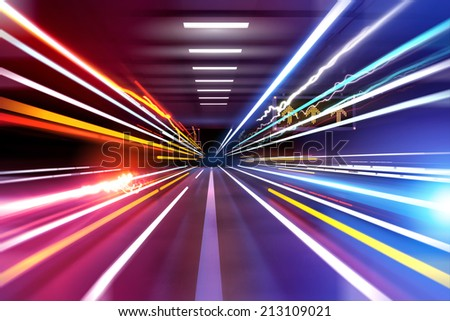 traffic light trails through an urban setting. Super fast! - stock photo