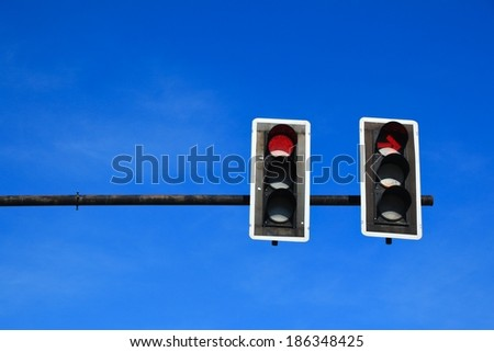 traffic light with a beautiful blue sky - stock photo