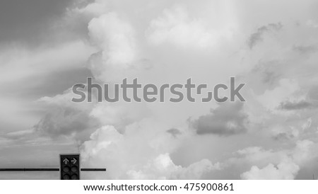 Traffic light with black and white sky background