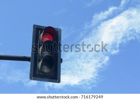 Traffic light with blue sky and white cloud, red for stop