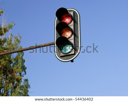 traffic light with blue sky background - stock photo