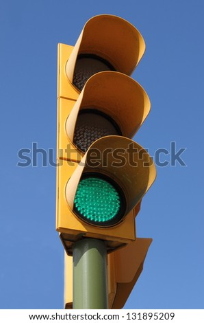 Traffic light with green light on - stock photo