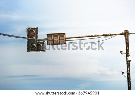 Traffic light with messy cable connection - stock photo