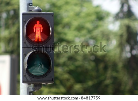 Traffic light with red sign for walkers to stop in urban ambiance
