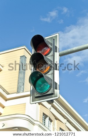 Traffic lights against sky backgrounds - stock photo