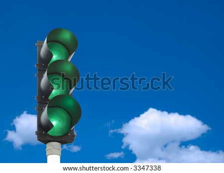 Traffic lights - all three lights are green in front of blue sky - stock photo