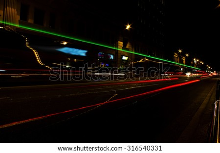 Traffic lights at night in Barcelona city (Spain) - stock photo