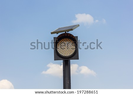 Traffic lights in front of blue sky. - stock photo