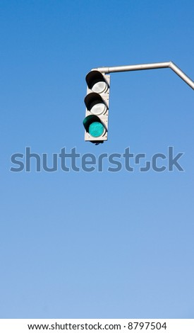 Traffic lights in front of blue sky - stock photo
