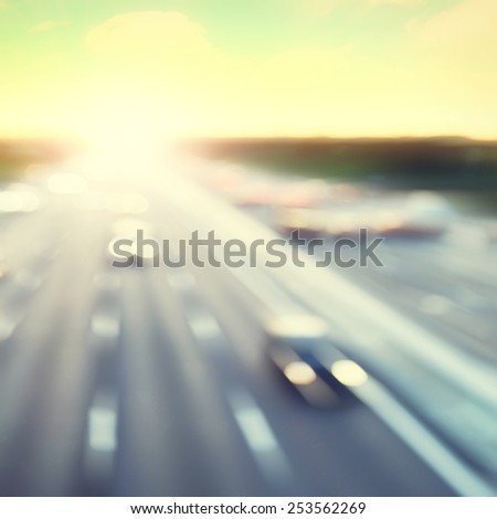 Traffic lights in motion blur during sunset. Vintage style. - stock photo