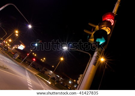traffic lights in the night - stock photo