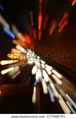 Traffic lights on street during rush hour at night. - stock photo