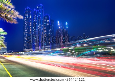 Traffic lights on the street of Abu Dhabi at night, UAE - stock photo