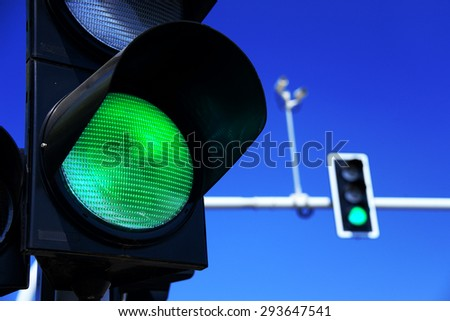 Traffic lights over blue sky - stock photo