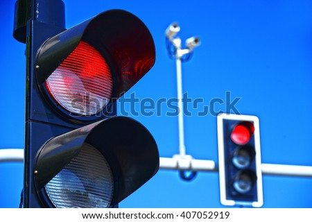 Traffic lights over blue sky. - stock photo