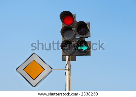 """traffic lights (red light) with additional section """"right turn"""" and sign """"main road"""" - stock photo"""