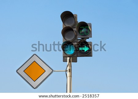 """traffic lights with additional section """"right turn"""" and sign """"main road"""" - stock photo"""