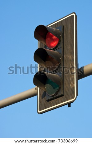 Traffic lights with red light illuminated - stock photo