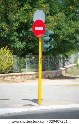 Traffic lights with stop sign on the street. - stock photo