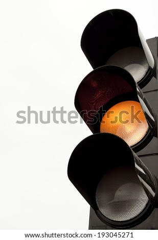 Traffic lights with the yellow light lit. - stock photo
