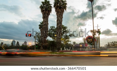 Traffic motion blur at roundabout in Nairobi city center - stock photo