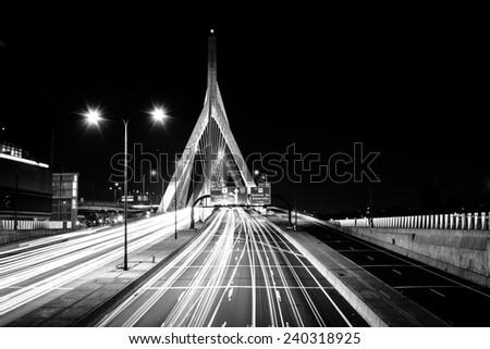 Traffic moving over the Leonard P. Zakim Bunker Hill Memorial Bridge at night, in Boston, Massachusetts. - stock photo