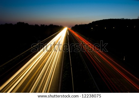 Traffic on a highway at night - stock photo