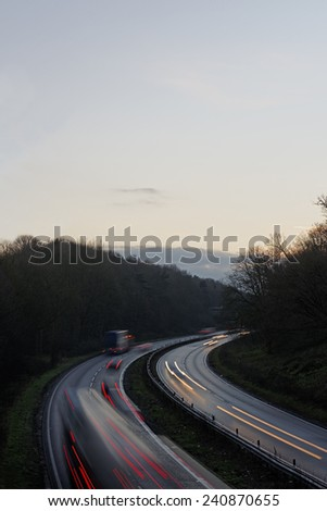 Traffic on a main road in the UK in winter at sunset. Travel concept. - stock photo