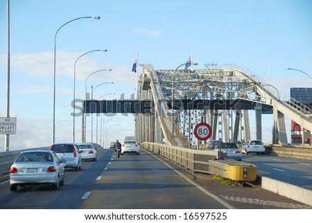 traffic on Auckland Harbor bridge, New Zealand - stock photo