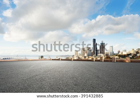traffic on city road through modern buildings in seattle - stock photo